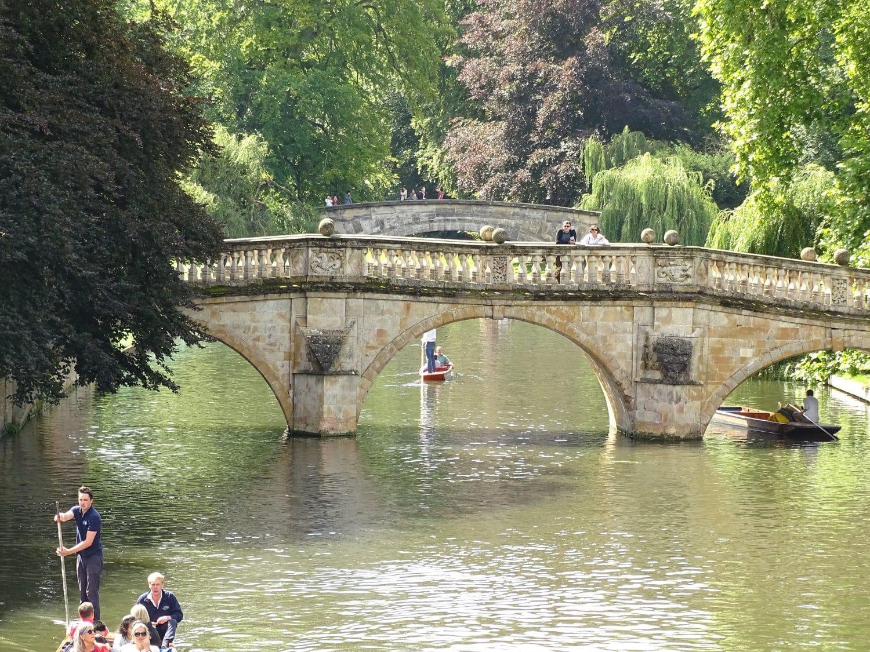 Glide under Cambridge's famouse bridges on a punt